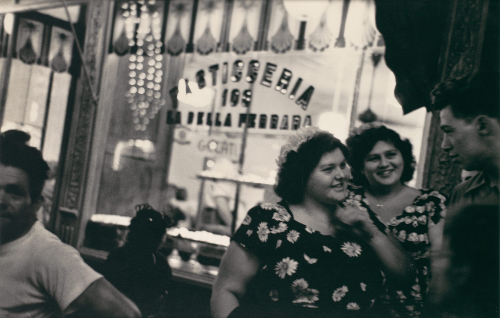 [Two Young Women before Pastry Shop at Night, Mulberry Street, Feast of San Gennaro, New York]