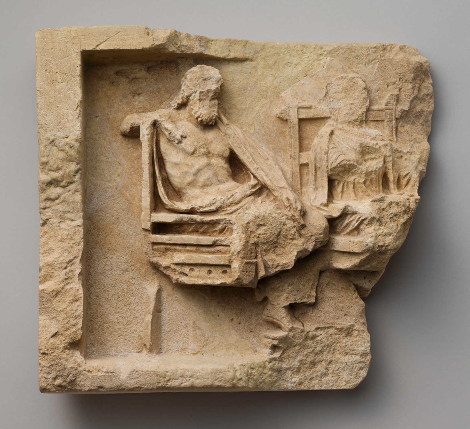 Fragment of a limestone relief with enthroned couple