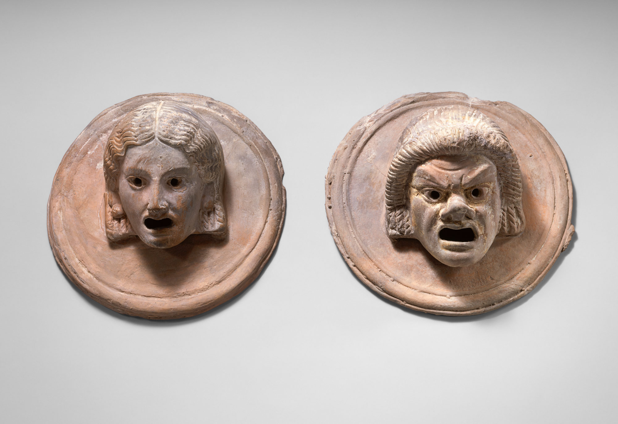 Two roundels with theater masks