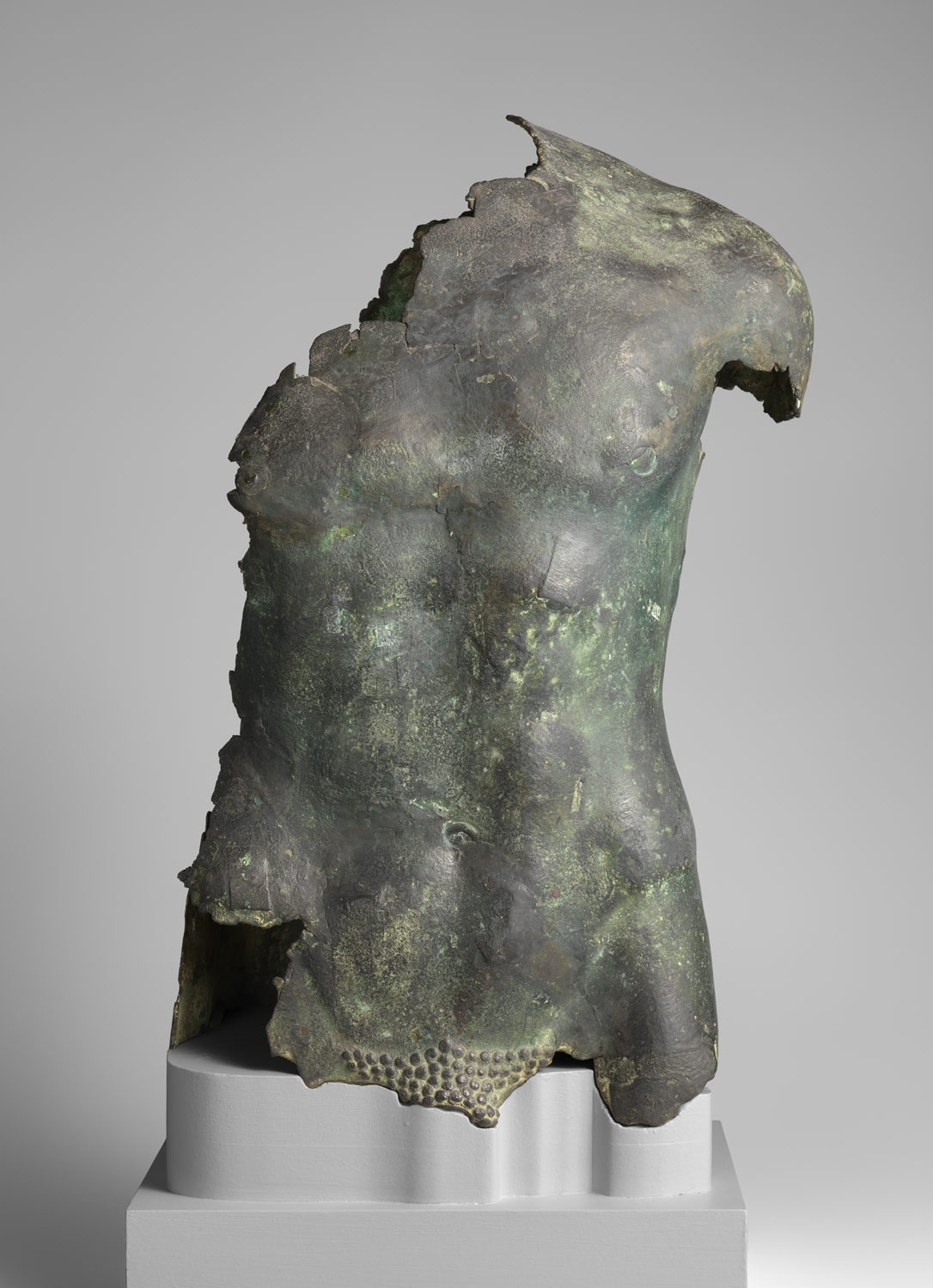 Bronze torso of a youth