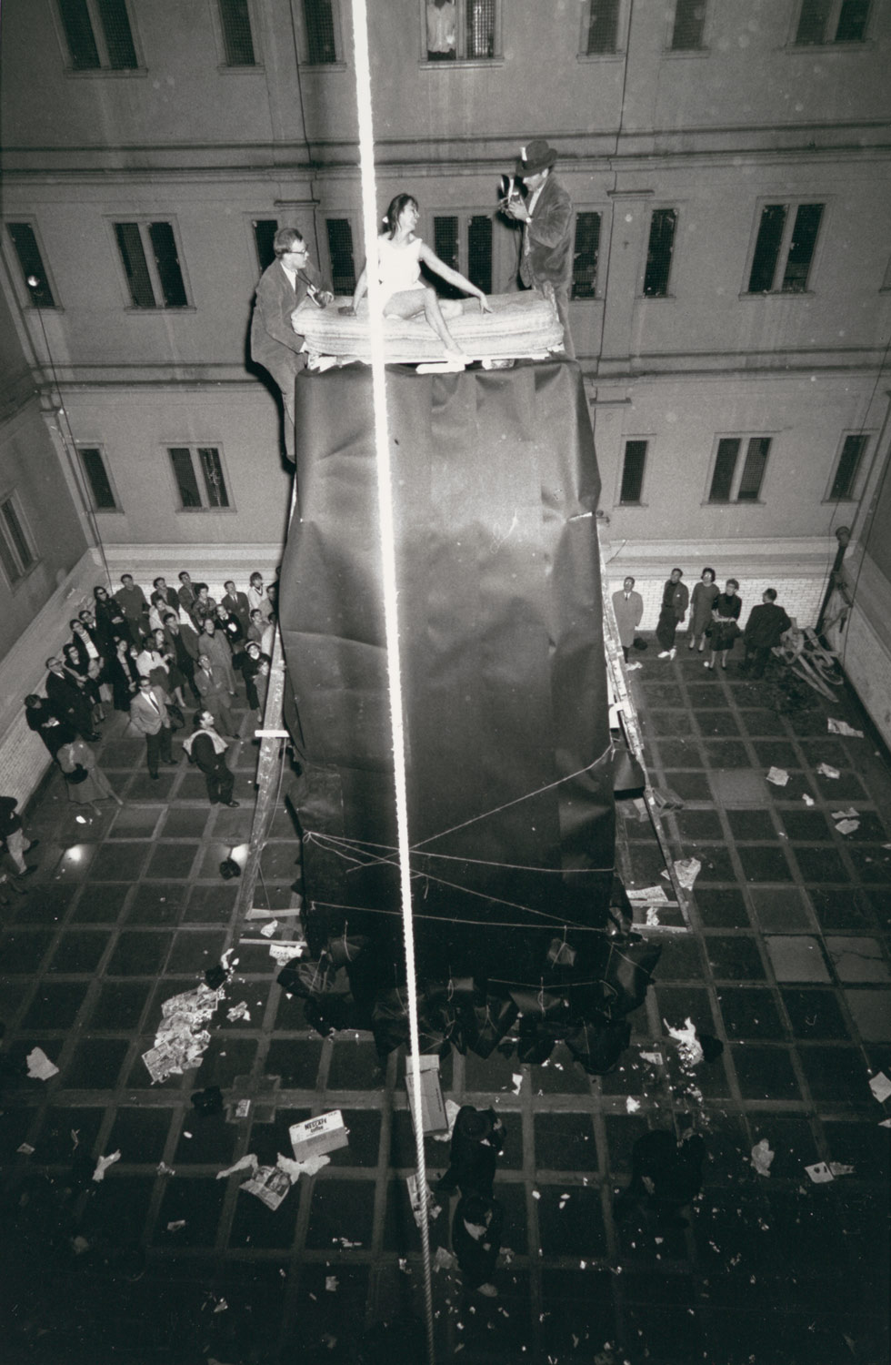 [William Mahin, Lette Eisenhauer, and Charles Simon Atop Giant Mountain Construction in The Courtyard, A Happening by Allan Kaprow, New York City]
