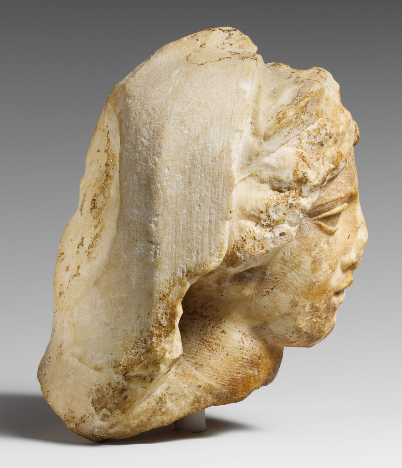 Marble head of a woman wearing diadem and veil