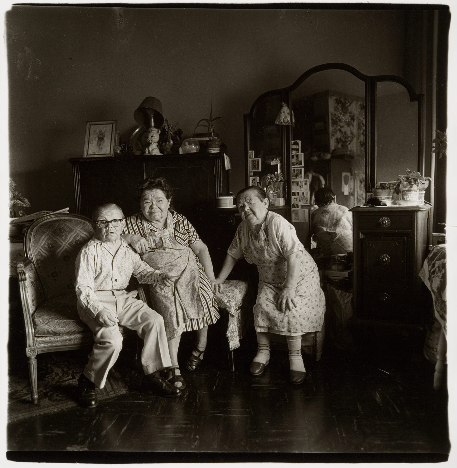 Russian midget friends in a living room on 100th Street, N.Y.C.