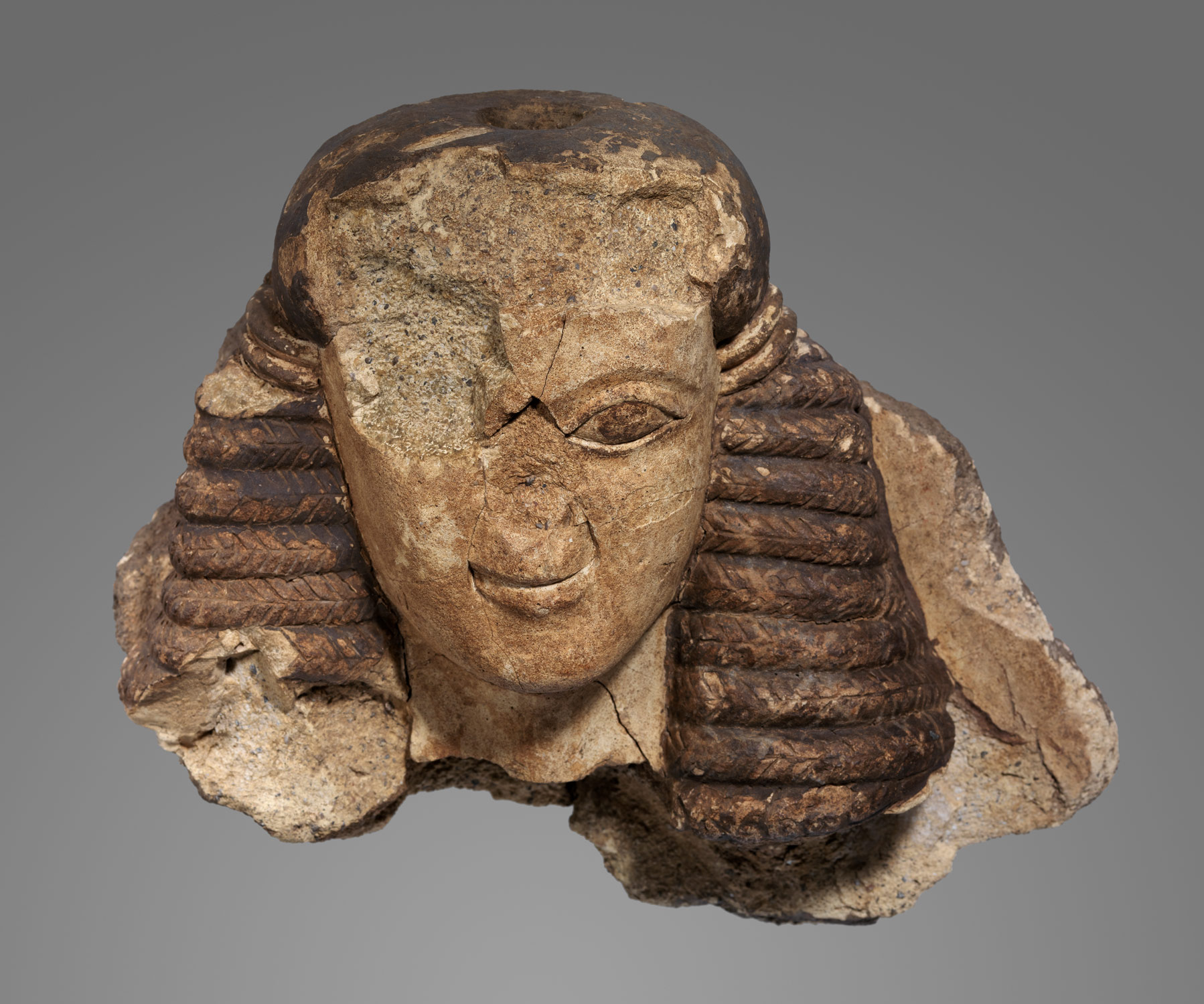 Antefix in the shape of a female head