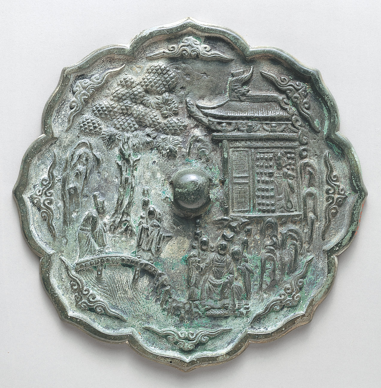 Mirror decorated with figures in a landscape