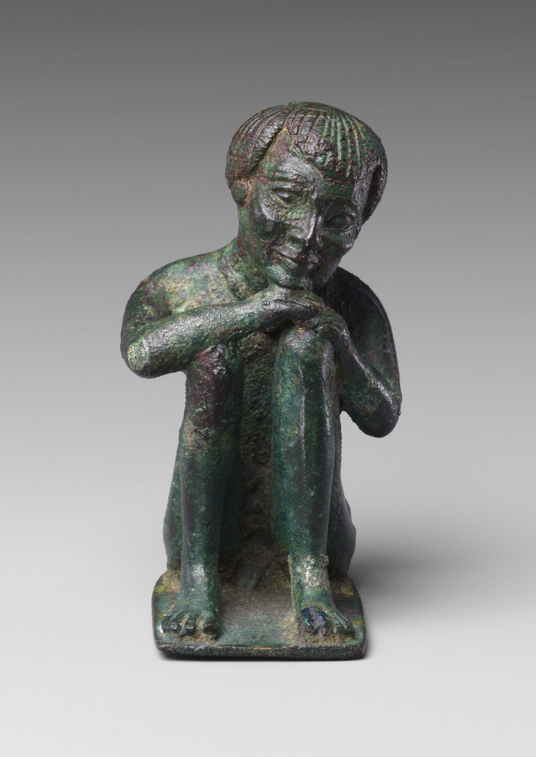 in the ptolemaic period essay heilbrunn timeline of art   man squatting head resting on his hands on his knees