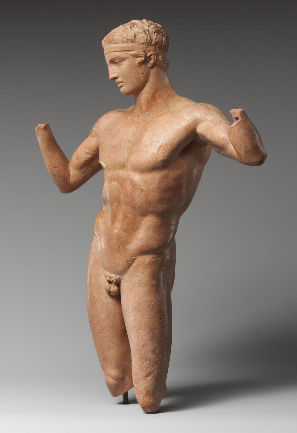 Terracotta statuette of the Diadoumenos (youth tying a fillet around his head)