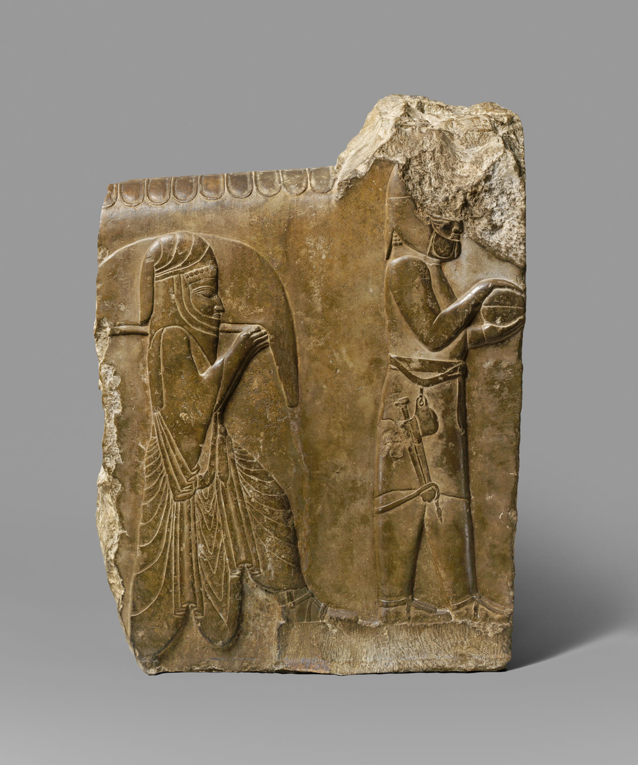 Relief with two servants bearing food and drink