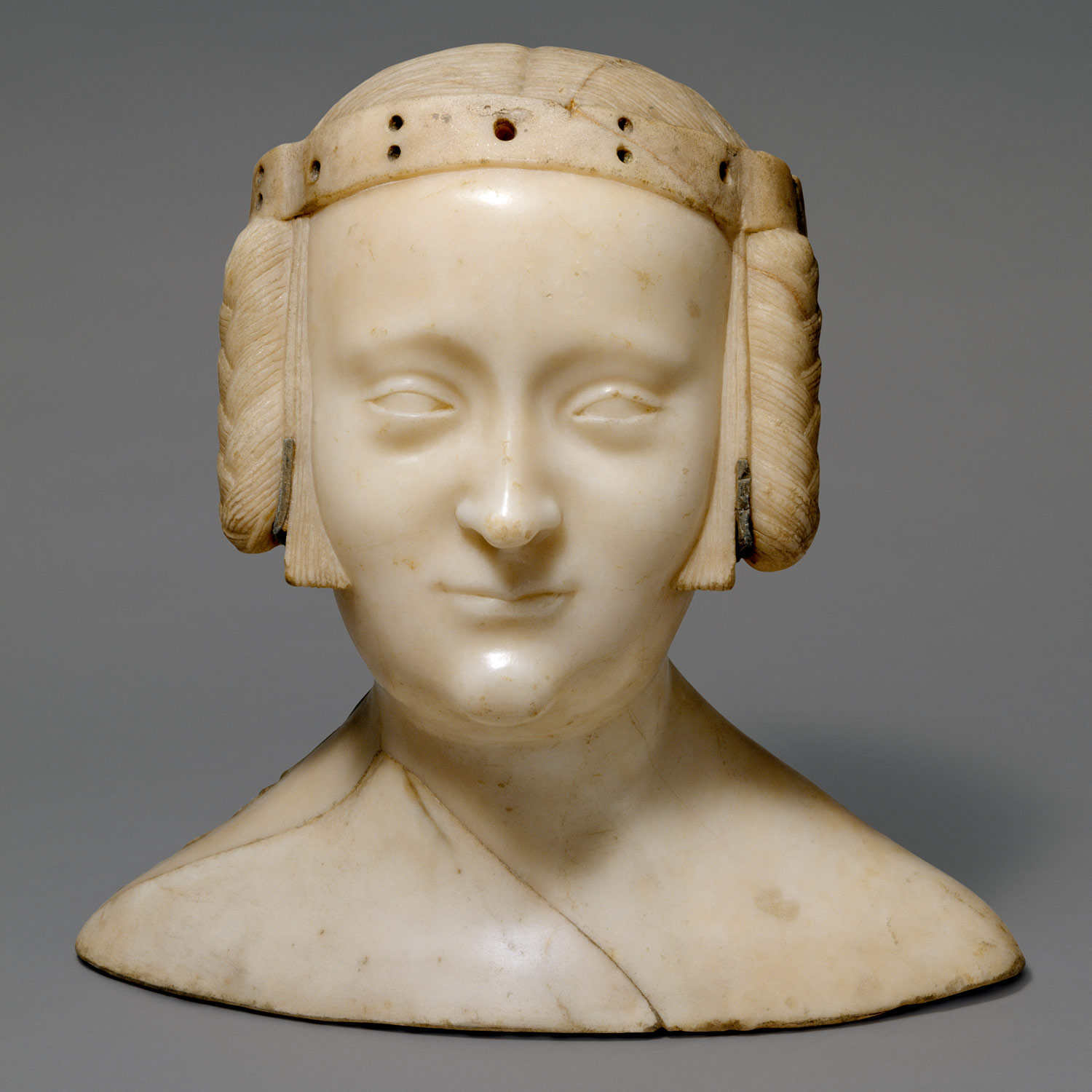 Carved marble bust of woman c. 1381