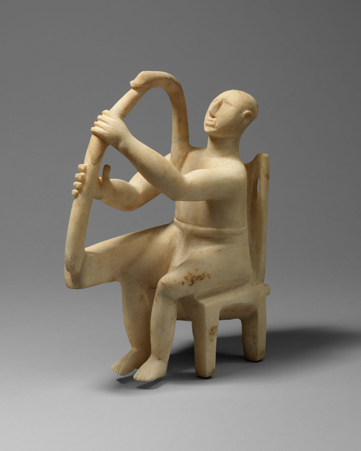 Marble seated harp player, 				,Stone Sculpture