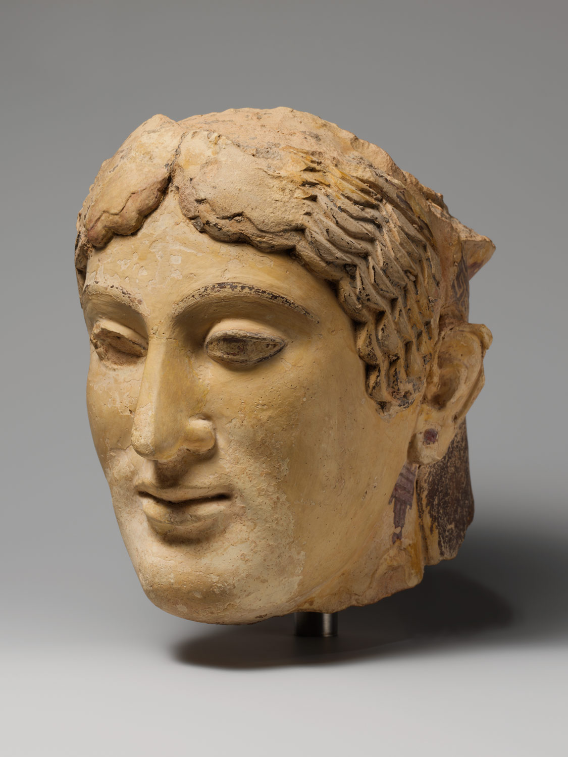 Terracotta head of a woman, probably a sphinx