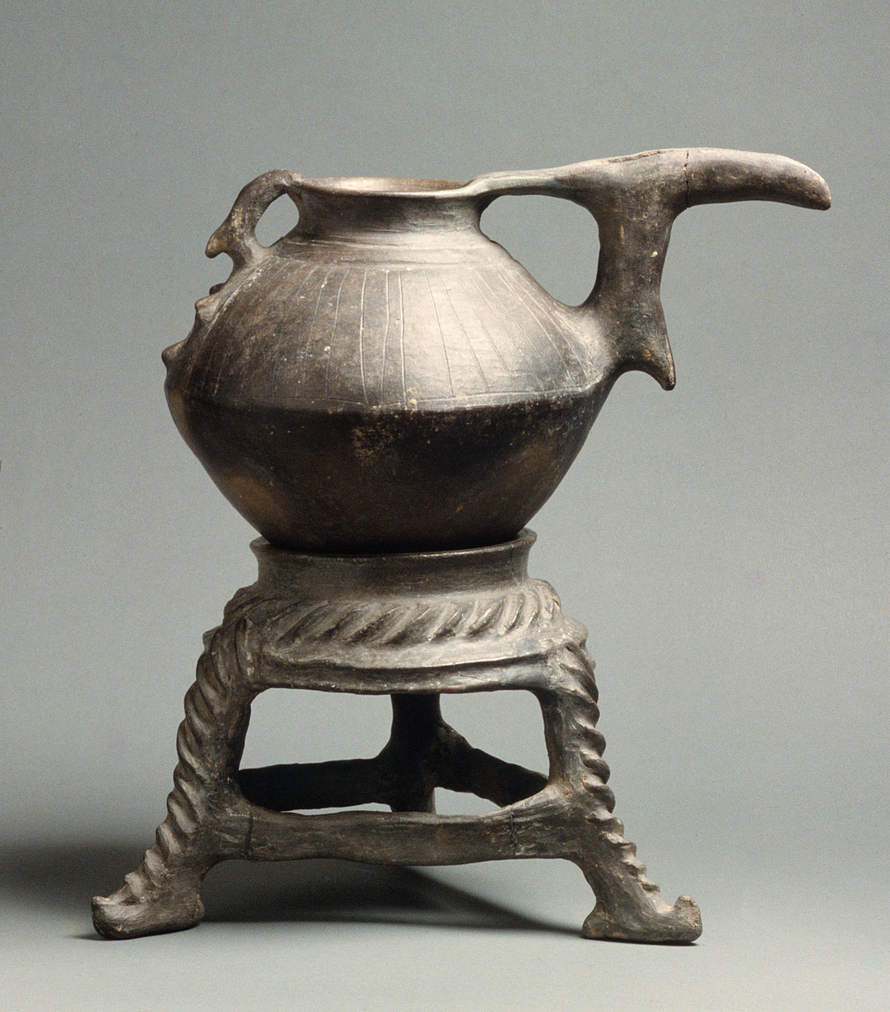 Spouted jar and stand