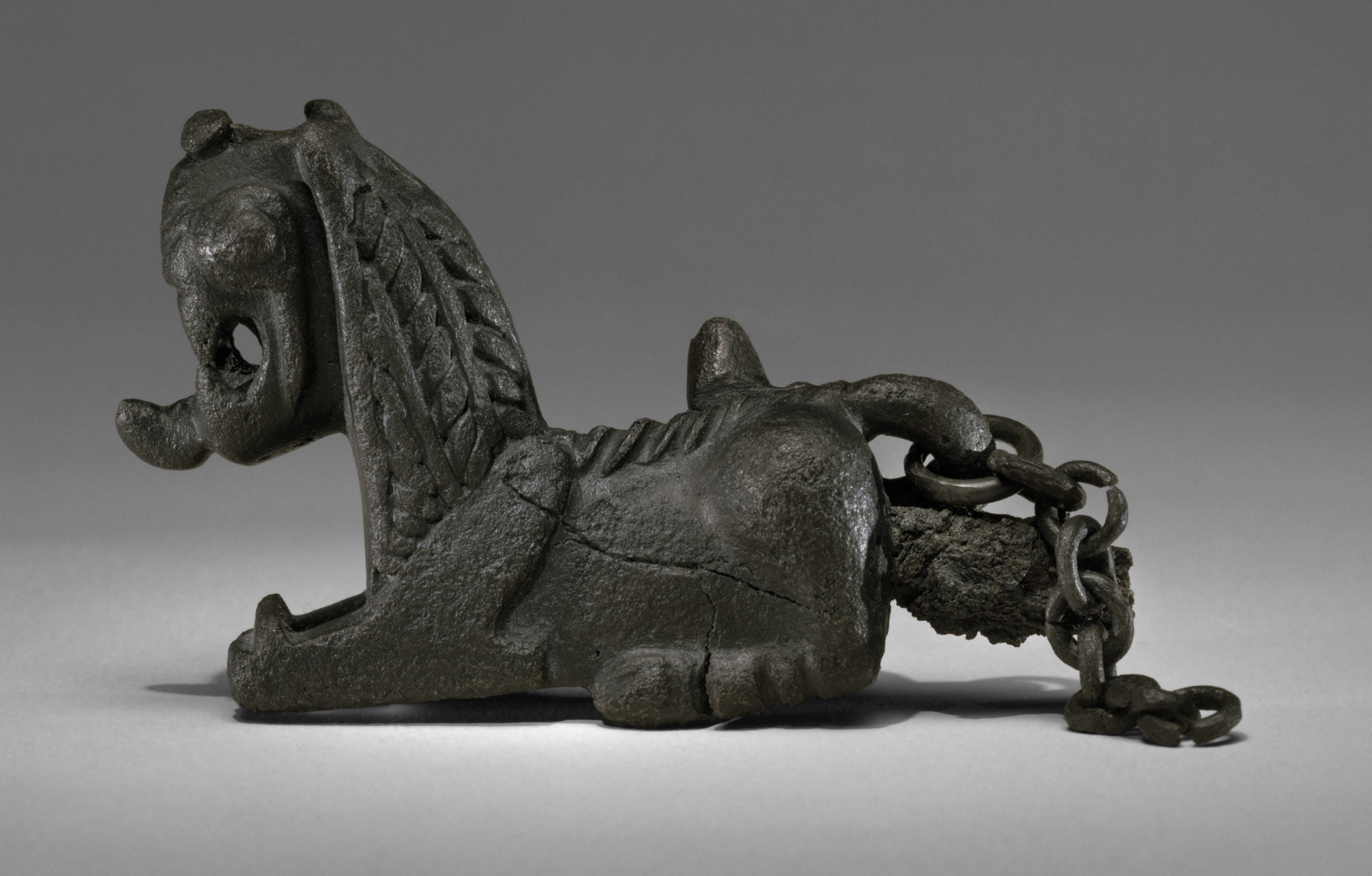 Pin with recumbent lion