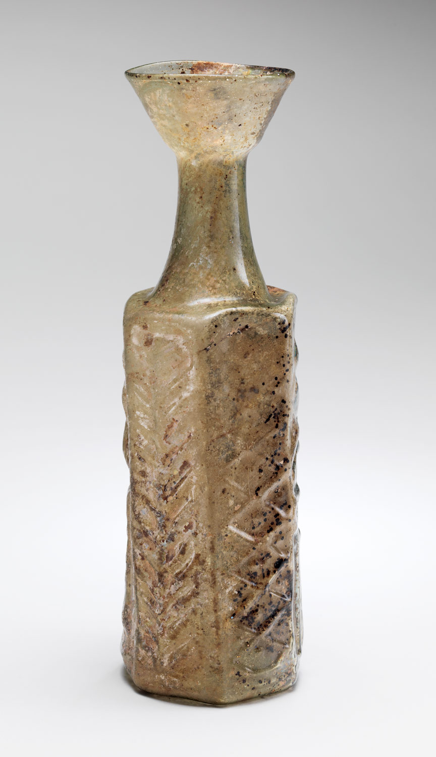 Yellow-Green Hexagonal Glass Bottle with a Stylite Saint