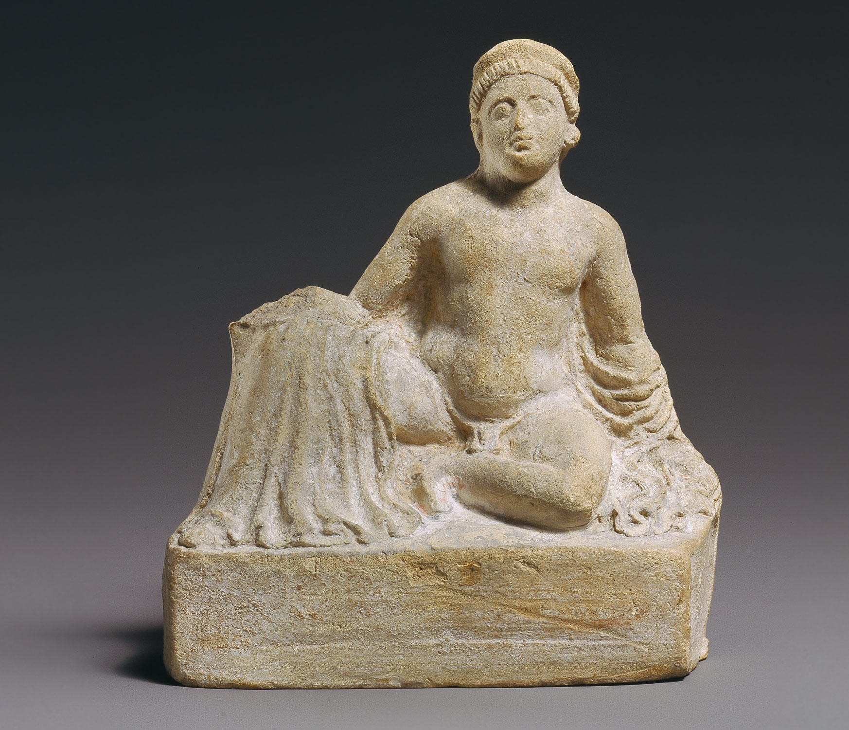 Terracotta statuette of a temple boy