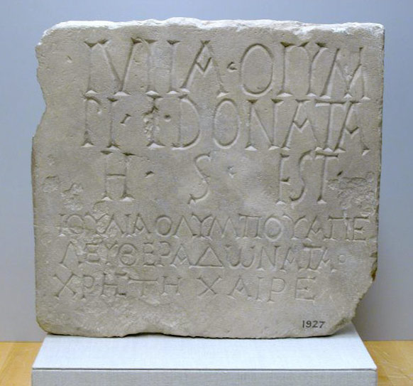 Limestone plaque with bilingual inscription
