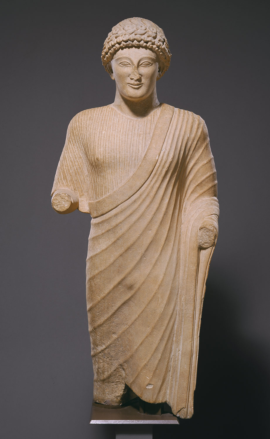 Limestone statue of a youth