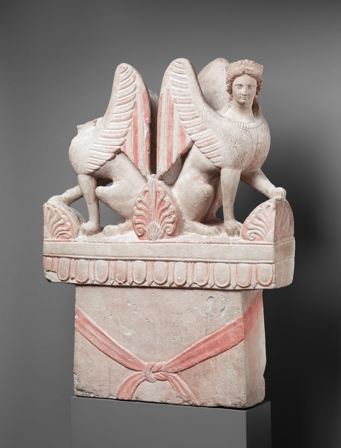 Limestone funerary stele (shaft) surmounted by two sphinxes