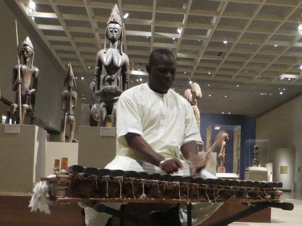 Famoro Dioubate performs in the Museum's African Art galleries