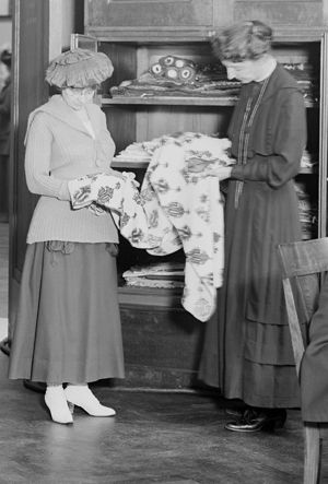 Frances Morris (right) in the Textile Study Room with a Museum patron, 1918