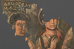 Textile fragment showing two people